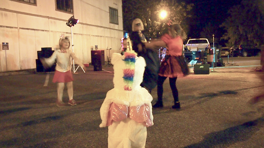 Little Unicorn watches kids dance during Halloween
