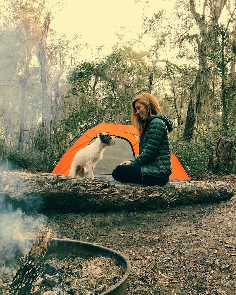 dog and owner in campsite at gold head state park, keystone heights, florida
