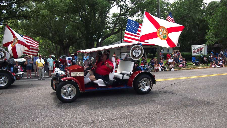Shriners make an appearance, in supped up cars, at the 4th of july parade in keystone heights.