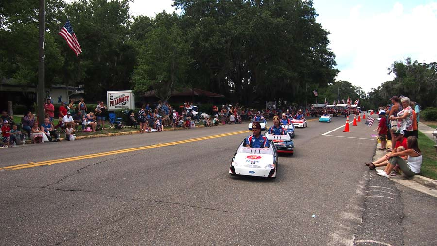 Shriners at keystone heights parade. In little cars, demonstrating their choreographic driving skils