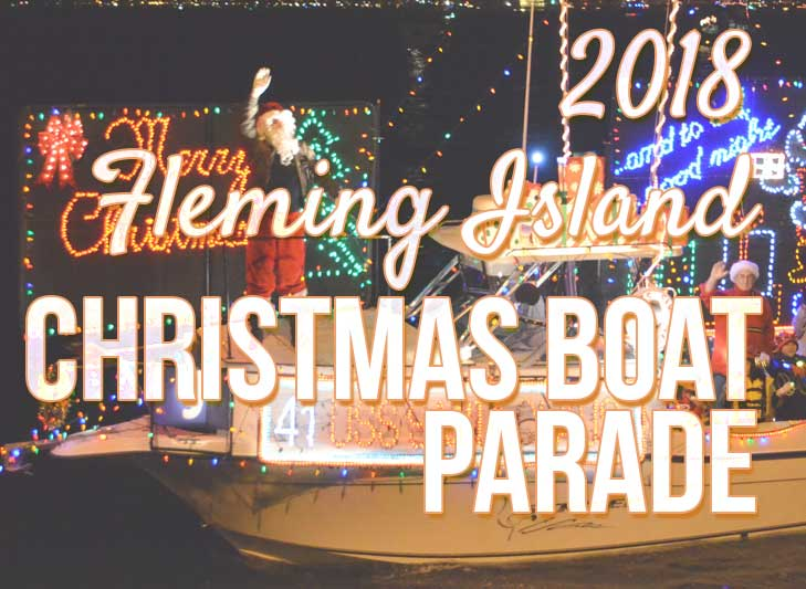 santa waving at audience in christmas boat parade at fleming island