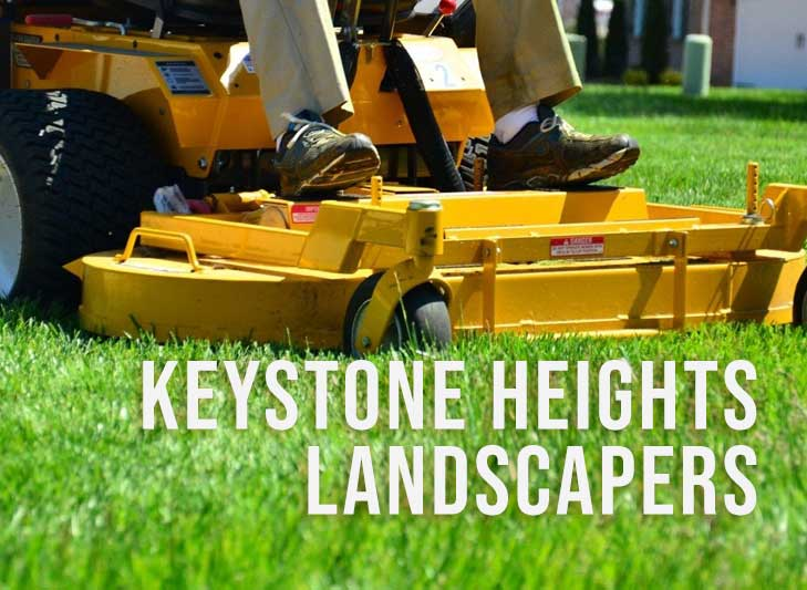a lawn mower cuts grass with the words keystone heights landscapers
